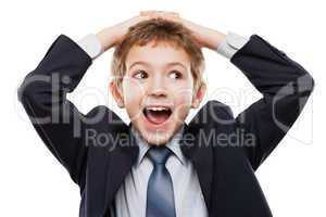 Amazed or surprised child boy in business suit holding hairs on