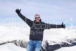 Guy is happy to be in the snowy mountains