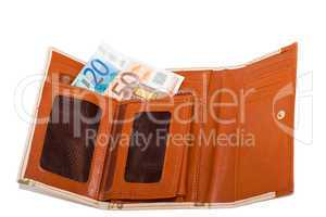 Wallet with monetary denominations on a white background
