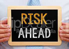 Risk ahead - Businessman with chalkboard