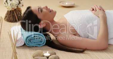 Long Hair Young Woman Lying Down in a Spa