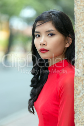 Attractive serious young Vietnamese woman