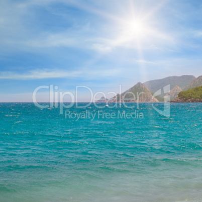 seascape, blue sky and mountainous coast