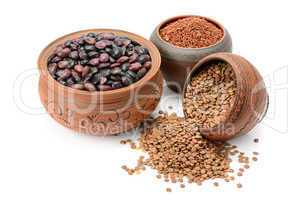 Beans, rice and lentils isolated on white background