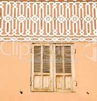 window in morocco  orange  construction wal brick historical