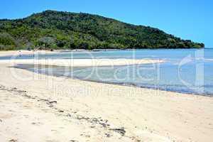 nosy be  beach seaweed in indian ocean madagascar  people   boat