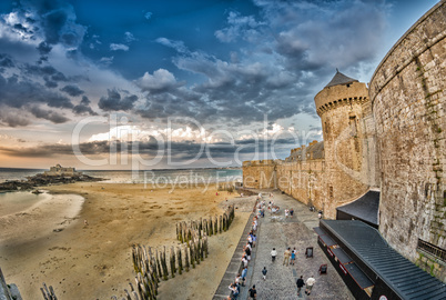 Saint Malo beach and city medieval architecture during Low Tide.