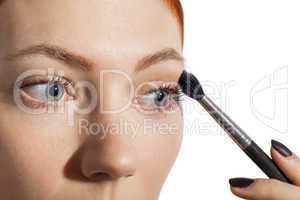 Pretty Woman Applying Eye Shadow Makeup