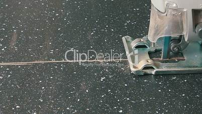Electric Jigsaw Cutting Wooden Board, closeup
