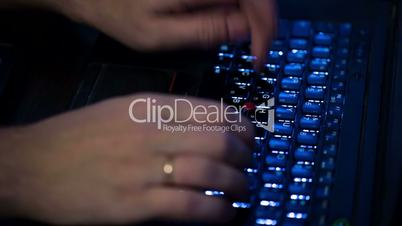 Male Hands Typing on the Keyboard Modern Laptop, close up view