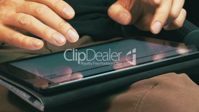 Male Hands Typing on a Tablet Computer, closeup