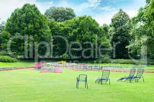 Lounge chairs in the summer park