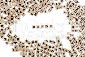 chaos written in small wooden cubes