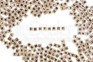 contract written in small wooden cubes