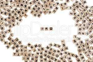 faq written in small wooden cubes