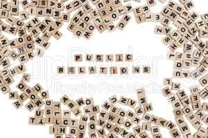 public relations written in small wooden cubes