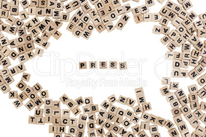press written in small wooden cubes