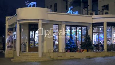 Cafe building with Christmas decoration at night