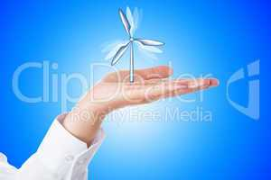 Wind Turbine Turning In A Palm On Blue Background