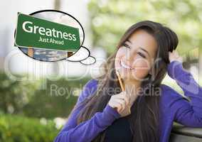 Young Woman with Thought Bubble of Greatness Green Road Sign