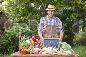 Happy farmer showing his produce