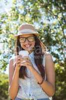 Pretty brunette having coffee to go