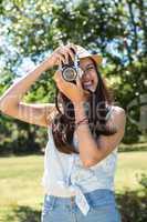 Pretty brunette using retro camera
