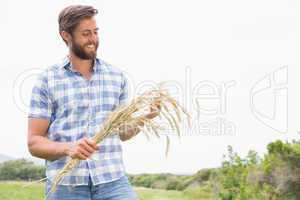 Happy man with his sheaf of wheat