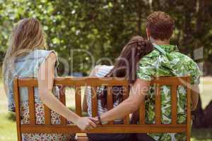 Young man holding hand of wrong girl