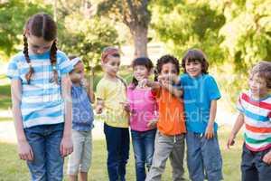 Little girl being bullied in park