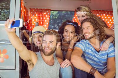 Hipster friends on road trip taking selfie