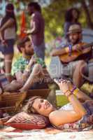Pretty hipster relaxing on campsite