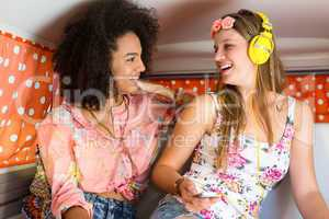 Happy friends on a road trip using listening to music