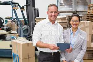 Warehouse manager and her boss working together