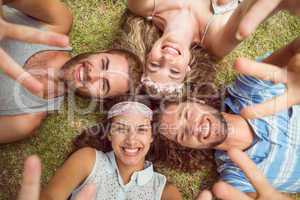 Hipsters lying on grass smiling