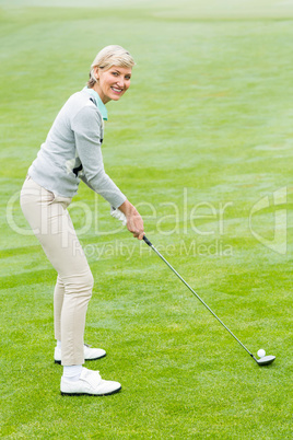 Lady golfer on the putting green