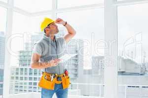 Handyman inspecting building