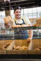 Portrait of smiling server offering bread