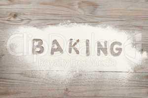 Word baking written in flour