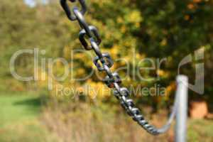 A metal chain on a green background