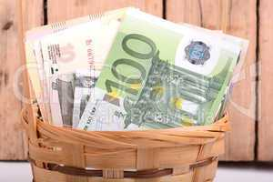 money set in a basket, dollars, euro and russian money