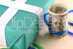 american money dollars and green gift box