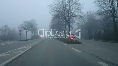Driving bad weather dense fog. View from car driver. Bad weather in Germany.
