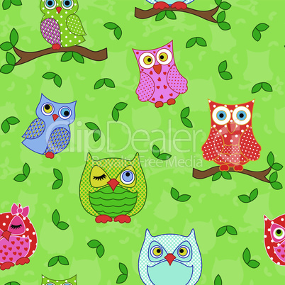 Seamless pattern with ornamental owls over light green