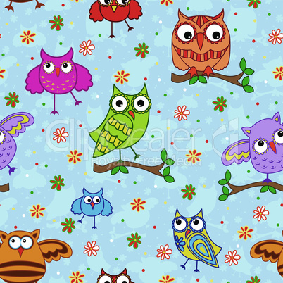 Seamless pattern with ornamental owls over blue