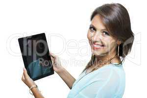 Pretty Woman Browsing at her Tablet Computer
