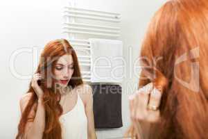 Mirror Reflection of a Long Hair Young Woman