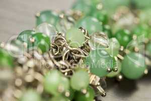 Green beads on an item of silver jewellery