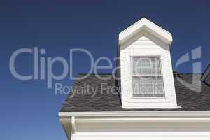 Roof of House and Windows Against Deep Blue Sky
