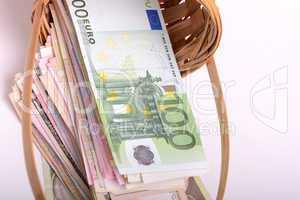 european money on wooden basket, dollars, euro
